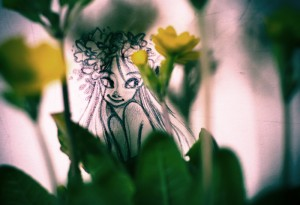 Pencil Sketch photographed with real Flowers